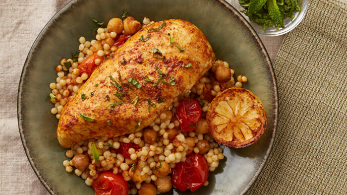 Moroccan Baked Chicken and Couscous with Tomatoes and Chickpeas