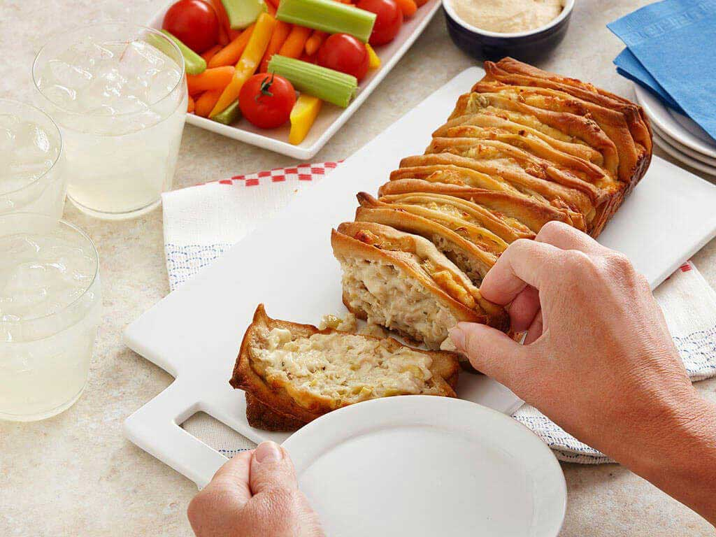Cheesy Herb and Artichoke Chicken Pull Apart Bread PERDUE®