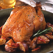 Cornish Hens with Fresh Herbs Served with Bacon-Sage Roasted Red Potatoes