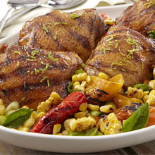 Grilled Coconut-Sazón Marinated Chicken Thighs with Corn Salad